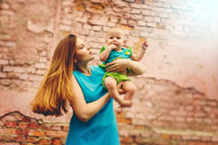 Cute Toddler Baby sitting on Mom`s Hands Royalty Free Stock Photography