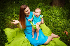 Cute Toddler Baby sitting on Mom`s Hands Stock Images