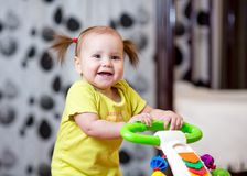 Cute toddler baby standing with support Stock Photography