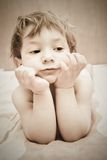 Cute toddler in bed Stock Photo
