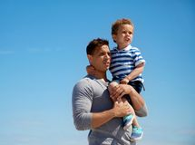 Cute Toddler Being Carried by Dad Royalty Free Stock Photo