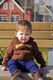 Cute toddler on a bench Royalty Free Stock Image