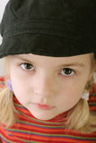 Cute toddler in black hat Royalty Free Stock Images