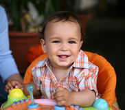 Cute toddler boy. Playing with toys and smiling Royalty Free Stock Photos