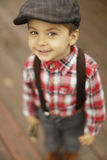 Cute toddler boy with beautiful eyes in vintage style hat Royalty Free Stock Image