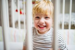 Cute toddler boy in the bedroom. Close up. stock images