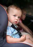 Cute toddler boy in car seat Royalty Free Stock Photography