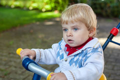 Cute toddler boy on children bycicle Stock Photography