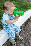 Cute toddler boy drinking water Royalty Free Stock Photos