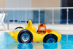 Cute toddler boy have a fun in pool outdoor Royalty Free Stock Photos