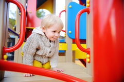 Cute toddler boy having fun on playground Stock Image