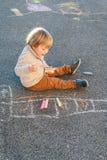 Cute toddler boy outdoors Stock Photos