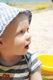 Cute toddler boy playing on the beach Stock Photography