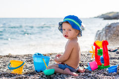 Cute toddler boy playing on the beach Royalty Free Stock Image