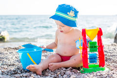 Cute toddler boy playing on the beach Royalty Free Stock Photos