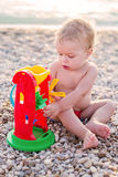 Cute toddler boy playing on the beach Stock Images