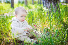 Cute toddler boy playing Stock Images