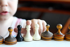 Cute toddler boy playing chess. Stock Images