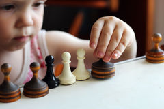 Cute toddler boy playing chess. Stock Image
