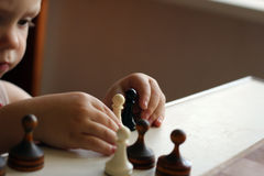 Cute toddler boy playing chess Royalty Free Stock Image