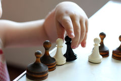 Cute toddler boy playing chess Royalty Free Stock Photo