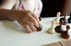 Cute toddler boy playing chess Royalty Free Stock Photos