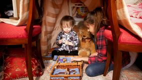 Cute toddler boy playing with elder sister in tent at bedroom. Toddler boy playing with elder sister in tent at bedroom Stock Images