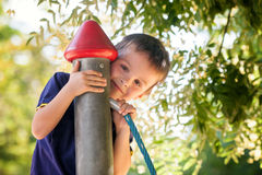 Cute toddler boy, playing on the playground Royalty Free Stock Photos