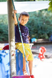 Cute toddler boy, playing on the playground Royalty Free Stock Image