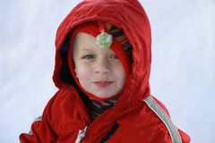 Cute Toddler boy in the snow. Young blonde boy playing in the snow Stock Photos
