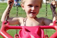 Cute Toddler Boy Swinging Royalty Free Stock Photo