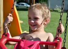 Cute Toddler Boy Swinging Royalty Free Stock Photography