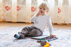 Cute toddler boy of two years eating chocolate Royalty Free Stock Photo