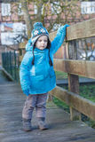 Cute toddler boy walking on wooden bridge Royalty Free Stock Photo
