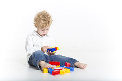 Cute toddler is building with legos royalty free stock image