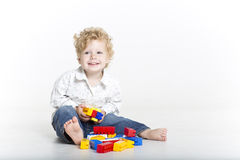 Cute toddler is building with legos Stock Image