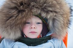 Cute toddler bundled up in warm clothes Stock Images