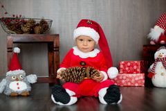 Cute toddler child, boy, playing with christmas decoration at ho stock images