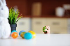 Cute toddler child hunting for easter egg on Easter day royalty free stock photo