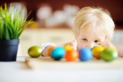 Cute toddler child hunting for easter egg on Easter day Royalty Free Stock Images
