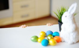Cute toddler child hunting for easter egg on Easter day stock photo