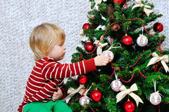 Cute toddler decorating Christmas tree Stock Photography