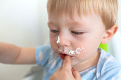Cute toddler eating cake Royalty Free Stock Images