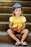 Cute toddler eating outdoors Stock Image