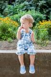 Cute toddler eating sweet straw sitting Royalty Free Stock Photos