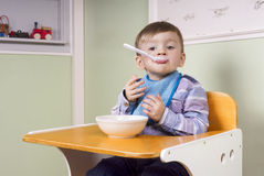 Cute toddler eating yogurt Stock Image