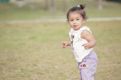Cute toddler exploring Stock Photo