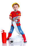 Cute toddler fireman. Expressive cute toddler boy with fireman's outfit on.  on the white background Stock Images