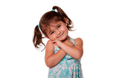 Cute toddler girl. Happy smiling toddler girl with beautiful cute expression and pigtails dressed in blue, isolated stock photo