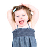 Cute Toddler Girl with arms above head. Cute toddler girl shouting hooray Stock Images